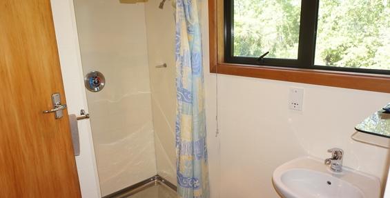 upstairs studio with balcony bathroom