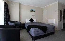 comfortable queen-size bed in studio unit