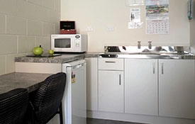 kitchen / dining area in studio unit
