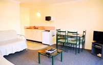 self-contained motel units have fully equipped kitchen with cooking elements and a microwave oven