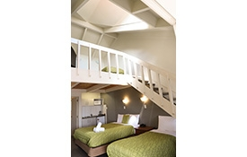 queen-size bed and single bed on ground floor