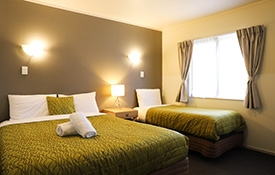 queen-size and single beds in the bedroom
