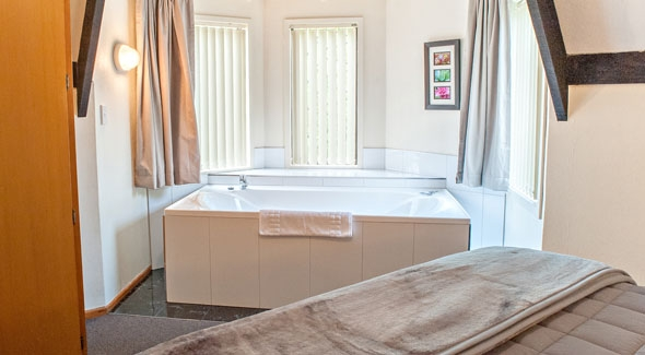 Image of a spa bath in a studio motel unit at Castles Motel in Nelson