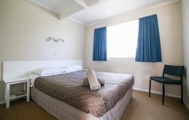 queen-size bed in 2-bedroom unit