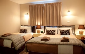 the room has queen-size and single beds