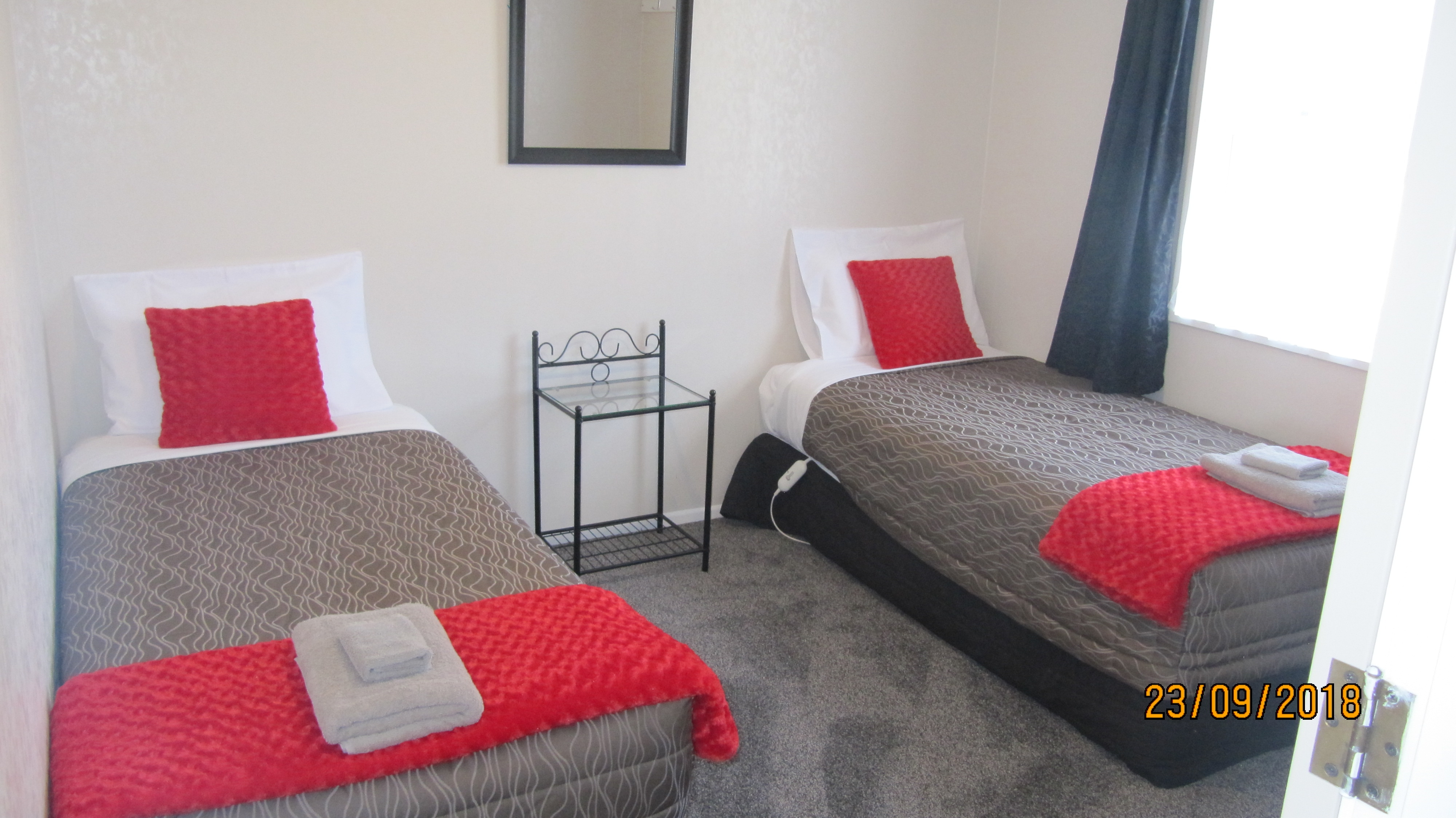 two single beds in a room of 3-bedroom unit