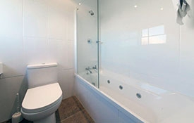 ensuite bathroom with a spa bath