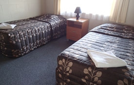 two single beds in the second room of 2-bedroom unit
