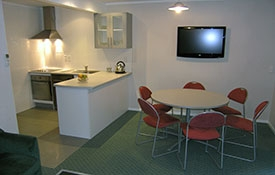 double-storey three-bedroom motel unit with full kitchen facilities