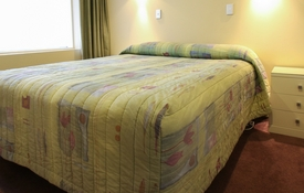Access Unit has queen-size bed in the room