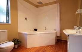 Studio room has double corner spa bath