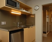 Kitchen with cooktop and microwave