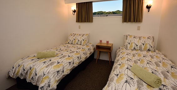 two single beds in the room