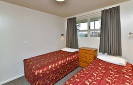 two-bedroom unit with queen-size bed in main room and twin beds in second room