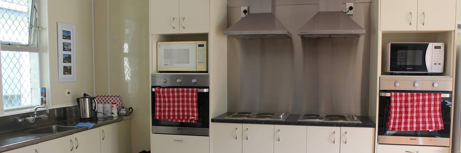 communal full-equipped kitchen for guests use
