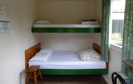 Backpackers Budget Cabin double bed and bunk