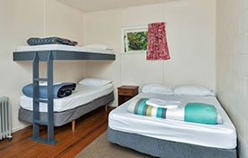 Standard Cabin bedroom with double bed and bunks