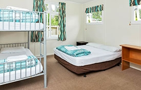Standard Cabin bedroom with bunks and double bed