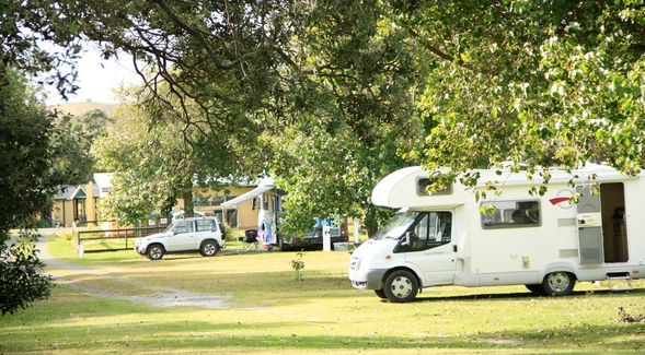 Image of Baylys Beach Holiday Park from the road