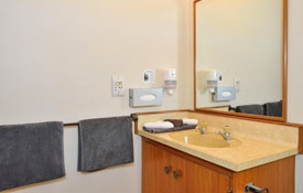 clean spacious bathroom of 1-bedroom unit