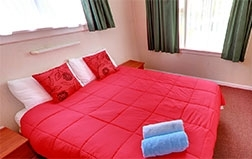 one bedroom unit with one queen bed and one single bed