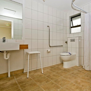 fully tiled private bathroom