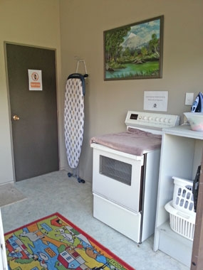 laundry room with iron board