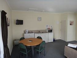 full stove,fridge and microwave in kitchen