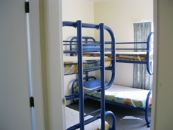 two sets of bunks in a separate room