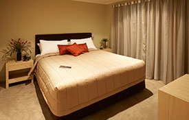king-size bed in the main room of 2-bedroom apartment