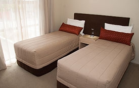 two single beds in the second room of 2-bedroom apartment