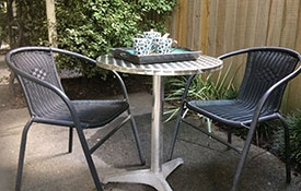 patio area with chairs and table