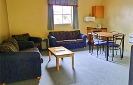 comfortable sofa and dining table chairs in units