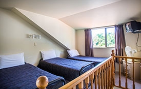 large bedroom with 4 single beds