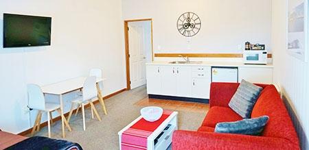 spacious studio with a small kitchen