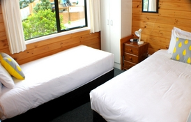 second bedroom contains two single beds