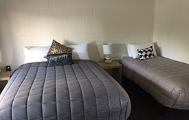 studio units with a queen-size bed and a single bed
