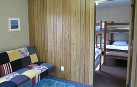 six single beds in the room and two sleep on double sofa bed - kitchen cabin