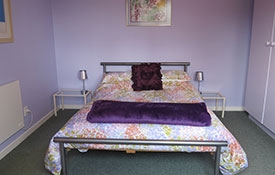 main bedroom of 2-bedroom unit has a double bed