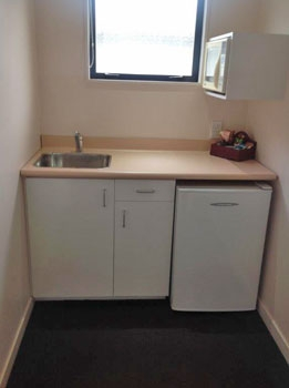 studio unit with small kitchenette