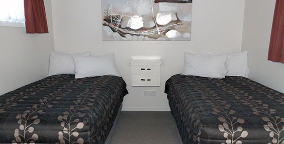two single beds in the second bedroom of 2-bedroom unit