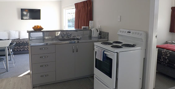 full kitchen facilities in large two-bedroom unit