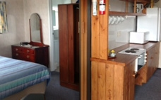 ground floor unit with a queen size bed and two single beds