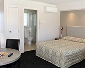 queen-size bed and a single bed in studio units