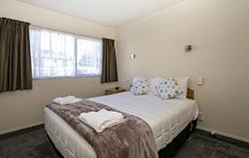 1-bedroom bedroom with queen-size bed