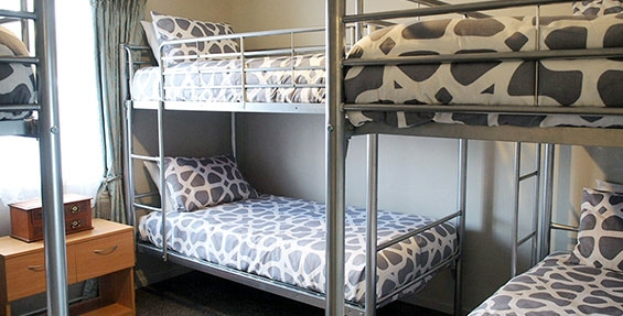 three sets of single bunks in second room of three-bedroom unit
