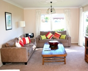 Spacious apartment accommodation living area at Pacific Palms Resort, Mt Maunganui