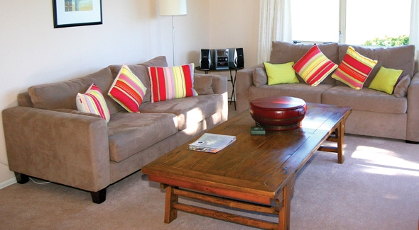 Lounge of a 2 bedroom apartment at Pacific Palms Resort in Papamoa, Tauranga