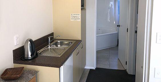 1-bedroom spa kitchenette and bathroom