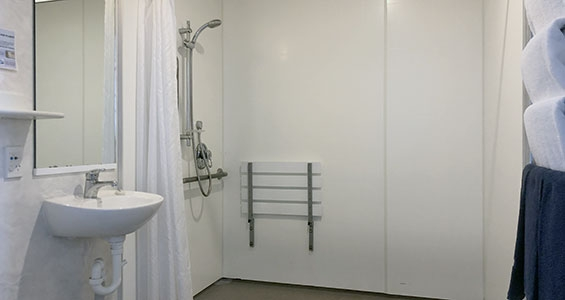 walk-in shower of Bowen one-bedroom suite with handrails